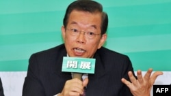 Former premier Frank Hsieh of the opposition Democratic Progressive Party speaks during a press conference in Taipei, October 1, 2012.