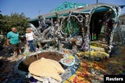 Artist Gonzalo Duran conducts a tour of the Mosaic Tile House created by artist Cheri Pann and himself in Venice, California, Aug. 26, 2016.