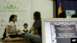 In foreground, a computer screen shows a message promoting awareness about Web blogs at Cambodian Bloggers Summit in the capital Phnom Penh, file photo.