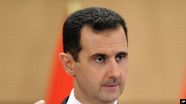 "Syria's President Bashar al-Assad delivers a speech in Damascus, Syria. Syria's embattled president says ""saboteurs"" are trying to exploit legitimate demands for reform in the country, Monday, June 20, 2011"