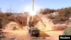 A still image taken from a video footage and released by Russia's Defence Ministry on November 15, 2016, shows Russian Bastion coastal missile launchers launching Oniks missiles at an unknown location in Syria.