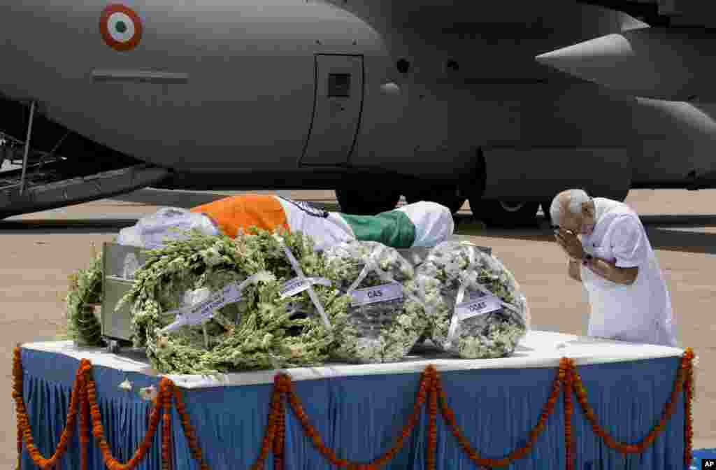 Indian Prime Minister Narendra Modi pays respect after the body of former President A.P.J. Abdul Kalam arrived at the Palam airport in New Delhi. Kalam, known as the father of the country's military missile program, died after collapsing while delivering a lecture, a top state official said. He was 83.