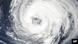 NASA's Aqua satellite captures this image of tropical Storm Talas over the western Pacific Ocean, September 1, 2011, as storm clouds reaches the southern shores of Japan.