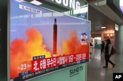 FILE - A TV screen shows a file image of a missile launch conducted by North Korea in a local news program, at Seoul Railway Station in Seoul, South Korea, Oct. 16, 2016.