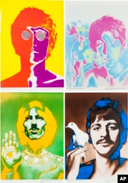 This undated photo provided by Heritage Auctions from an upcoming Beatles collection sale shows a set of four psychedelic posters by Richard Avedon commissioned by the German magazine Stern in 1966, which will be auctioned in New York on Sept. 19.