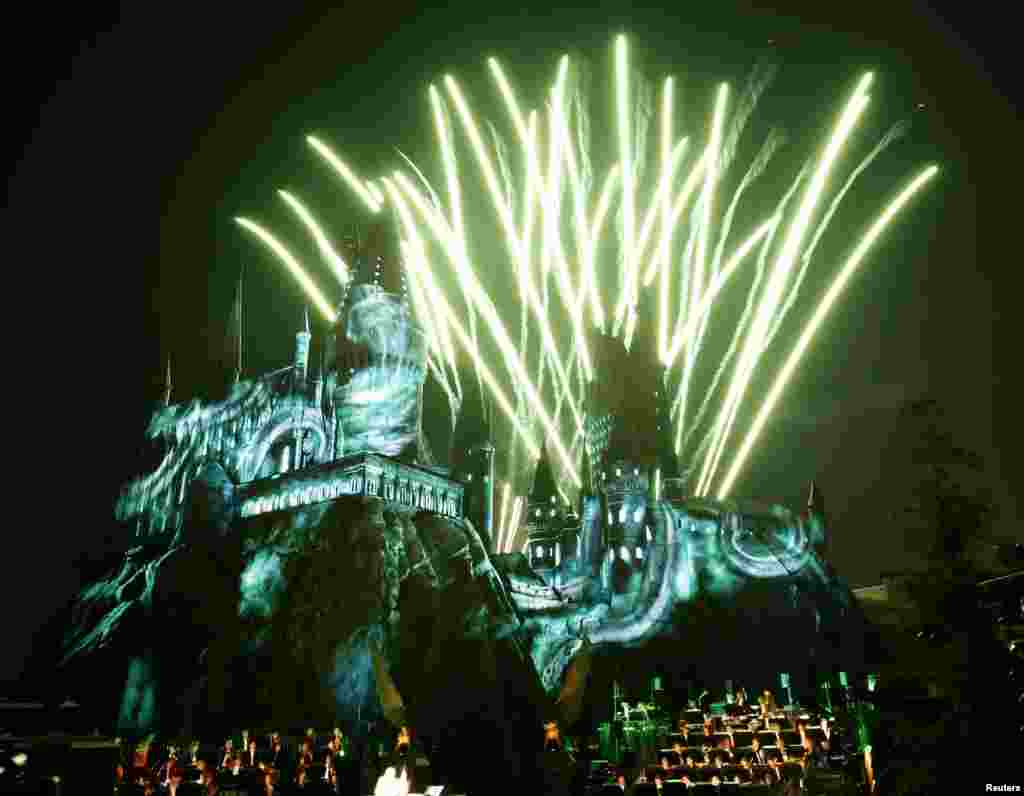 "Fireworks explode over a reproduction of Hogwarts Castle, as the Los Angeles Philharmonic performs under the direction of composer John Williams, during a special preview opening of ""The Wizarding World of Harry Potter"" attraction at Universal Studios Hollywood in University City, California, April 5, 2016."
