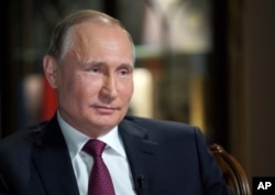 FILE - Russian President Vladimir Putin speaks during an interview with NBC News' Megyn Kelly in Kaliningrad, Russia, March 2, 2018.