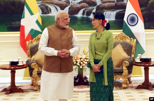 FILE - Myanmar's leader Aung San Suu Kyi, right, speaks with India's Prime Minister Narendra Modi, left, at the Presidential Palace in Naypyitaw, Myanmar, Sept 6, 2017.