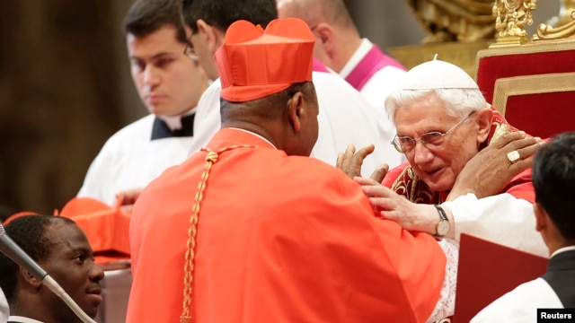 Pope Benedict XVI greets new Cardinal John Olorunfemi Onaiyekan of Nigeria during a consistory ceremony in Saint Peter's Basilica at the Vatican November 24, 2012.