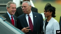 FILE - Former President George W. Bush arrives at Shannon Airport in western Ireland with Colin Powell, who was then his secretary of state, and Condoleeza Rice, who was his national security adviser, June 25, 2004.