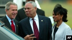 Former President George W. Bush arrives at Shannon Airport in western Ireland with Colin Powell, who was then his secretary of state, and Condoleeza Rice, who was his national security adviser, June 25, 2004. Rice later became secretary of state.