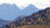 Pilots of the Patrouille Suisse perform in their Northrop F-5E Tiger II fighter jets during a flight demonstration of the Swiss Air Force over the Axalp in the Bernese Oberland, Switzerland October 20, 2021.