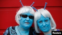 FILE - Science fiction enthusiasts Anne Clothier (L) and Gail Tomlinson, dressed as Andorians from Star Trek, pose for a photograph outside the 12th annual Sci-Fi London festival in east London, April 28, 2013.