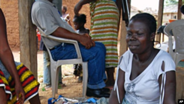 Refugee women in Tuzon, Liberia gather and sell produce to make money to feed their children