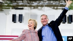 Democratic presidential candidate Hillary Clinton and Sen. Tim Kaine, D-Va., participate in a rally at Northern Virginia Community College in Annandale, Virginia, July 14, 2016.