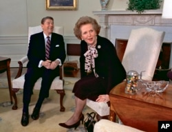 Then-British Prime Minister Margaret Thatcher meets with President Ronald Reagan during a visit to the White House, Feb. 20, 1985.