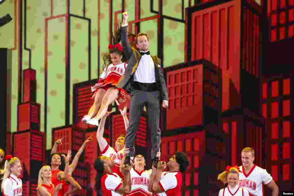 """Actor Neil Patrick Harris performs with the cast of the musical """"Bring it On"""" as he hosts the Tony Awards in New York, June 9, 2013."""