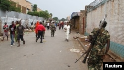 FILE - A soldier patrols the streets after a grenade attack in Burundi's capital, Bujumbura, Feb. 3, 2016. Burundi has been plagued by violence since President Pierre Nkurunziza ran for a controversial third term last year.