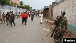 FILE - A soldier patrols the streets after a grenade attack of Burundi's capital Bujumbura, Feb. 3, 2016. The East African Community (EAC), meeting in Arusha, Tanzania Wednesday named the 77-year old Mkapa to hopefully breed new life into talks.