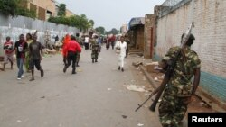 FILE - A soldier patrols a street after a grenade attack in Burundi's capital Bujumbura, Feb. 3, 2016.