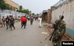 FILE - A soldier patrols the streets after a grenade attack of Burundi's capital Bujumbura, Feb. 3, 2016.