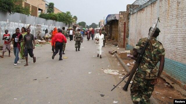 FILE - A soldier patrols a street after a grenade attack in Burundi's capital Bujumbura, Feb. 3, 2016.