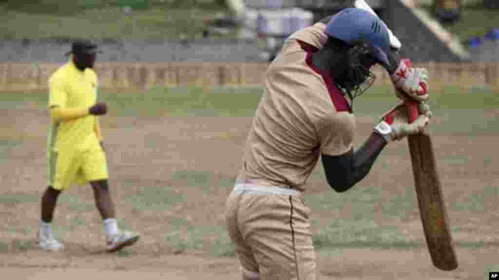 Men practice cricket at Tafawa Balewa Square in Lagos.