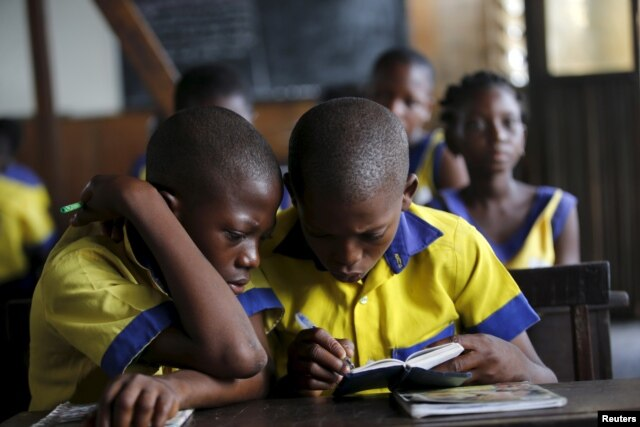 Students read a book at the Makoko floating school on the Lagos Lagoon, Nigeria, Feb. 29, 2016.