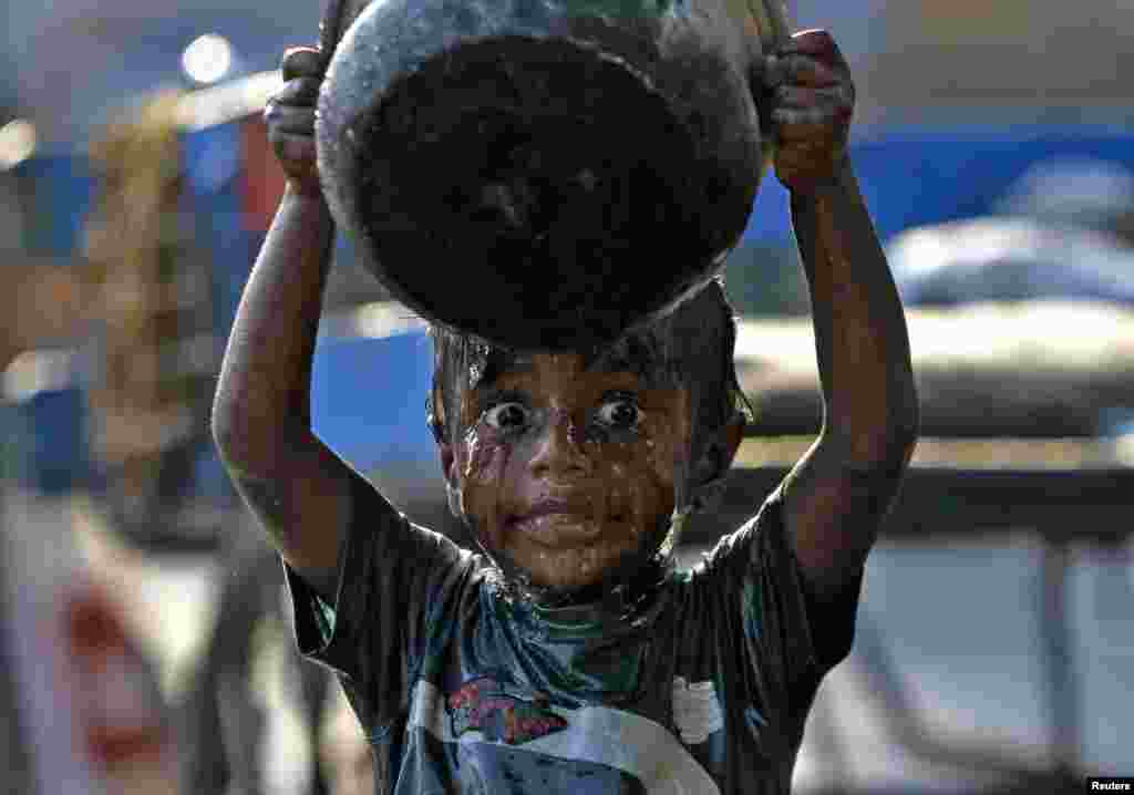 A boy takes a bath along a pavement in the southern Indian city of Chennai. World Water Day is celebrated on March 22.