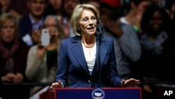 Betsy DeVos, selected for education secretary by President-elect Donald Trump, speaks in Grand Rapids, Michigan, Dec. 9, 2016. DeVos and her organization, the American Federation for Children, have been advocates for the channeling of more federal funding to private and charter schools.