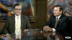 Opposition leaders Sam Rainsy and Kem Sokha in VOA studio In Washington, DC, file photo.