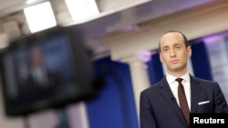 FILE - Senior White House Adviser Stephen Miller waits to go on the air in the White House Briefing Room in Washington, Feb. 12, 2017.
