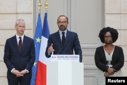 French Culture Minister Franck Riester, French Prime Minister Edouard Philippe and French Junior Minister and Government's spokesperson Sibeth Ndiaye attend a news conference after the weekly cabinet meeting, dominated by the aftermath of the Notre-Dame c