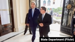 U.S. Secretary of State John Kerry and Cuban Foreign Minister Bruno Rodríguez enter the Cuban Ministry of Foreign Affairs before their bilateral meeting during the Secretary's historic visit to Havana on August 14, 2015.