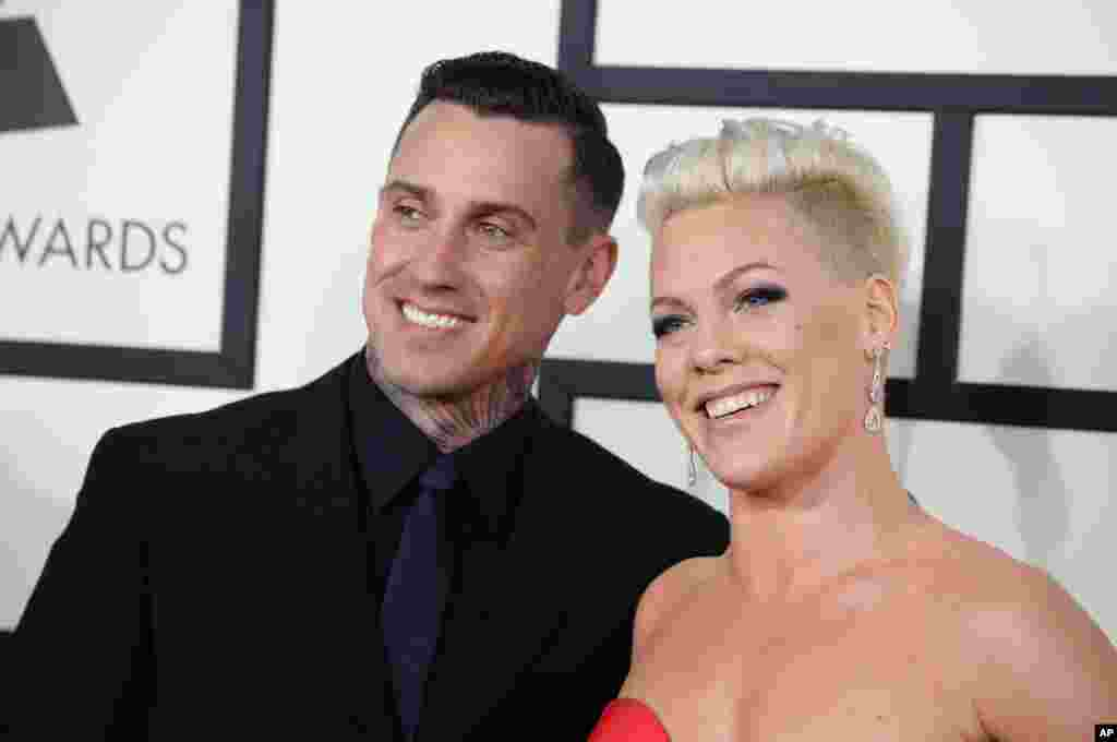 Carey Hart, left, and Pink arrive at the 56th annual GRAMMY Awards at Staples Center on Jan. 26, 2014, in Los Angeles.
