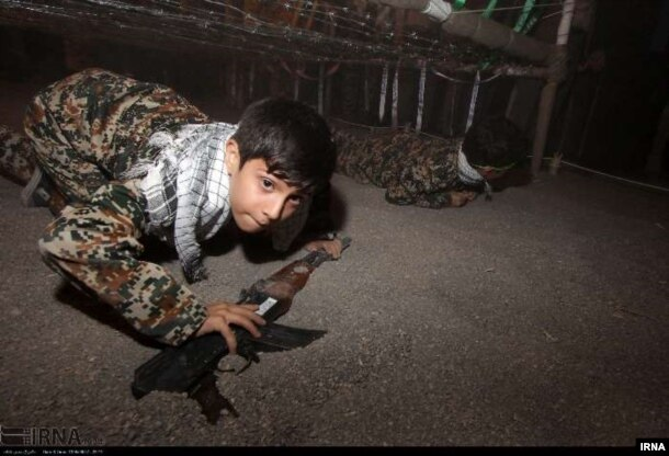 Iranian children are taught how to use firearms for battle, according to a post on Iran's state-run news agency IRNA.