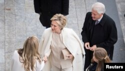 Former Secretary of State Hillary Clinton and former President Bill Clinton arrive prior to the inauguration for Donald Trump as 45th U.S. president in Washington, D.C., Jan. 20, 2017.