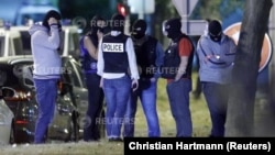 French policemen take part in a police raid in Boussy-Saint-Antoine near Paris, France, September 8, 2016. French police investigating the abandonment of a car packed with gas cylinders near Paris's Notre Dame cathedral last Saturday, arrested three women