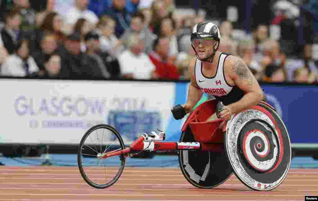 Canada's Josh Cassidy looks at the scoreboard after competing in Round 1 of the Men's Para-Sport 1500m T54 at the 2014 Commonwealth Games in Glasgow, Scotland.