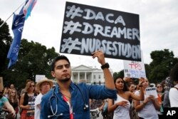 FILE - Carlos Esteban, 31, of Woodbridge, Va., a nursing student and recipient of Deferred Action for Childhood Arrivals, known as DACA, rallies with others in support of DACA outside of the White House, in Washington, Sept. 5, 2017.