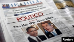 American political newspapers feature headlines about and images of U.S. President Barack Obama and House Speaker John Boehner (R-OH) on Capitol Hill in Washington, Feb. 26, 2013.