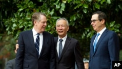 Chinese Vice Premier Liu He accompanied by U.S. Trade Representative Robert Lighthizer, left, and Treasury Secretary Steven Mnuchin, greets the media before a minister-level trade meeting in Washington, Thursday, Oct. 10, 2019.