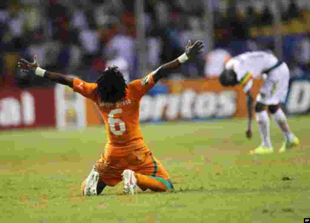 Ivory Coast's Gosso Jean-Jacques Gosso celebrates after they won during their African Nations Cup semi-final soccer match against Mali at the Stade De L'Amitie Stadium in Gabon's capital Libreville February 8, 2012.