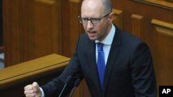 Ukrainian Prime Minister Arseniy Yatsenyuk speaks to the parliament in Kyiv, Ukraine, July 24, 2014.