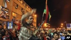 Rebeldes líbios depois da tomada de Bengazi