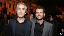 "Writer-director Jonas Cuaron and his father, Oscar-winning filmmaker Alfonso Cuaron, are seen at STX Entertainment's premiere of ""Desierto"" at the 2016 L.A. Film Festival's closing night in Culver City, Calif., June 9, 2016."
