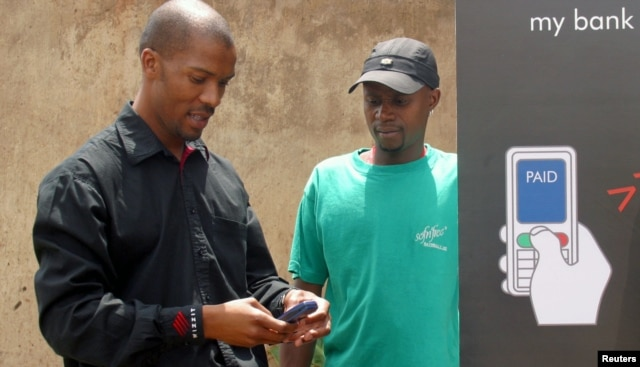 Cell phones are serving as a bank in your pocket, providing virtual accounts for South Africans excluded from the financial mainstream, Johannesburg's Soweto township, October 19, 2005.