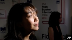 Winner of the 2016 Man Booker International prize for fiction Han Kang speaks to the media after winning the award for her book 'The Vegetarian' after the award ceremony in London, Tuesday, May, 16, 2016.