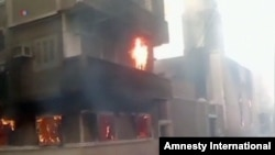 FILE - A Coptic church burning in Egypt.