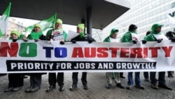 European Trade Union Confederation (ETUC) members demonstrate against European austerity measures at the EU Commission headquarters in Brussels.
